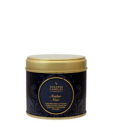 Ароматна свещ Amber Noir в метална кутия с аромат на цветя, амбър и виолетки