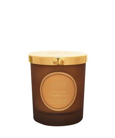 Ароматна свещ в цветно стъкло и натурални аромати с аромат на сандалово дърво, какао, ванилия
