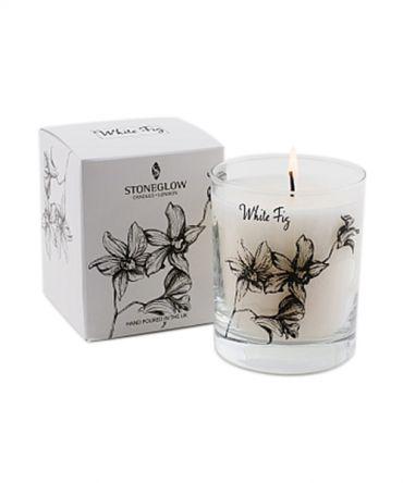 Ароматна свещ в стъклена чаша с аромат на бяла смокиня