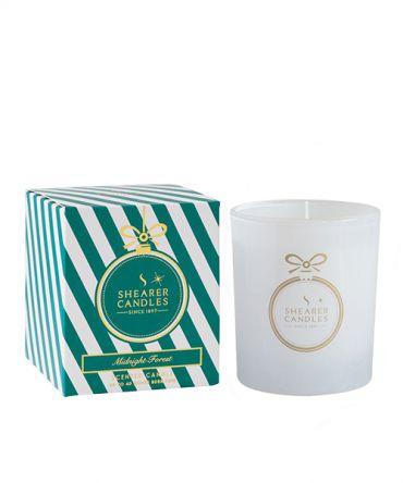 Коледна ароматна свещ в празнична кутия за подарък с аромат на бор, евкалипт, кедрово дърво и градински чай. Подходяща за коледни декорации и коледни подаръци