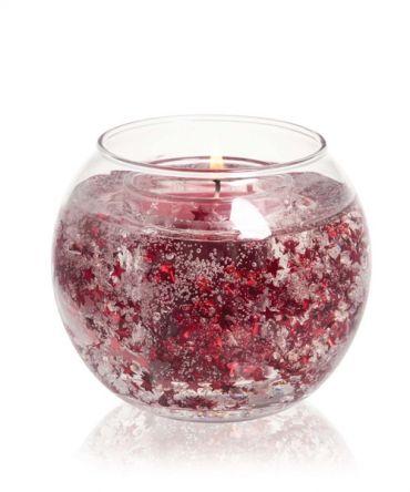 Коледна свещ с аромат на пикантни подправки, сандалово дърво и чедър.